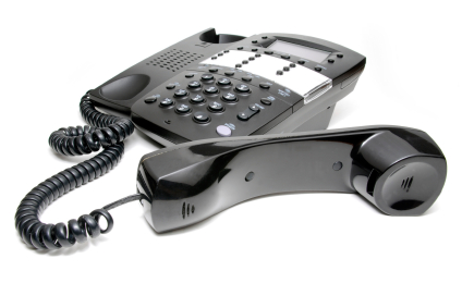 Isolated Black Business Telephone with Receiver off the Hook